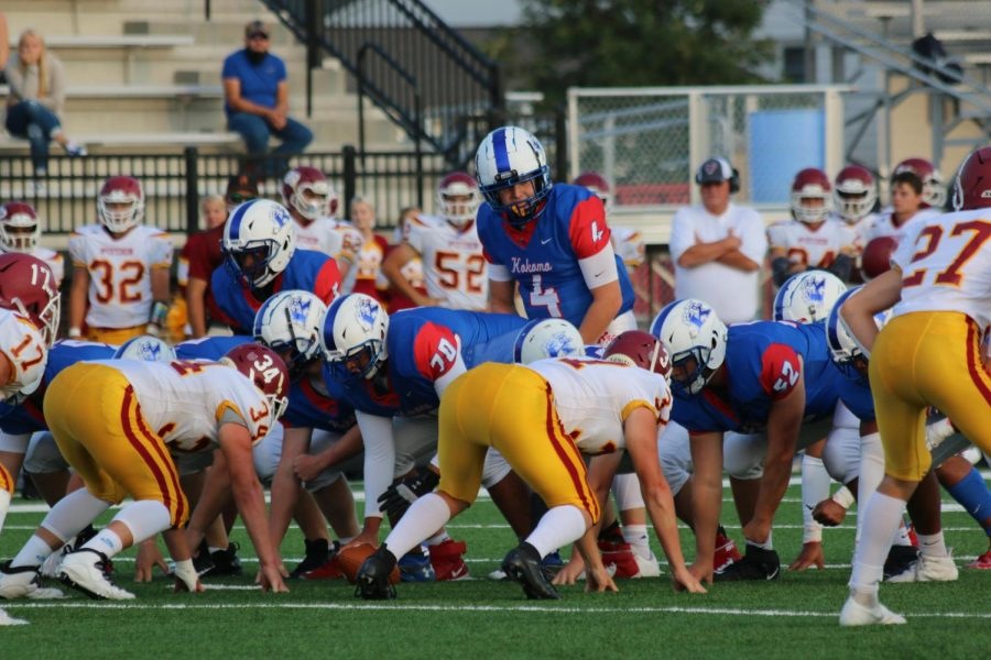 Evan Barker calls the play from the line of scrimmage during the Kats