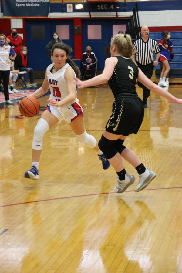 Junior Chloe McClain drives around one of her opponents during the LadyKats game against Peru. McClain and the Kats host McCutcheon tonight for a boys-girls double header.