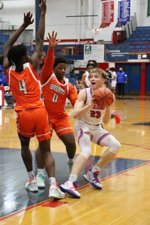 Senior Jackson Richards tries to shoot the ball around two of his Ft. Wayne opponents. Richards and the Kats take on Lafayette Jeff tonight.