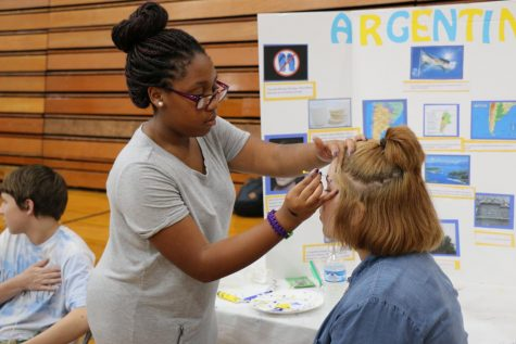 Students participate in face-painting at one of the International Festival booths. The festival returns this year after being canceled in 2020.