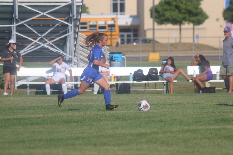Senior Emily Riggle dribbles the ball towards the goal in a home game against the Marion Giants. Riggle and the Ladykats defeated the Giants 6-0.