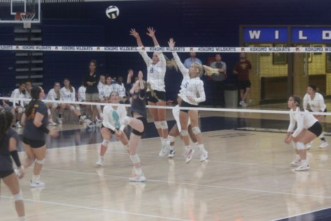 Sophomores Abby Hansen and Dani Tate block the ball at the net during a home volleyball match.