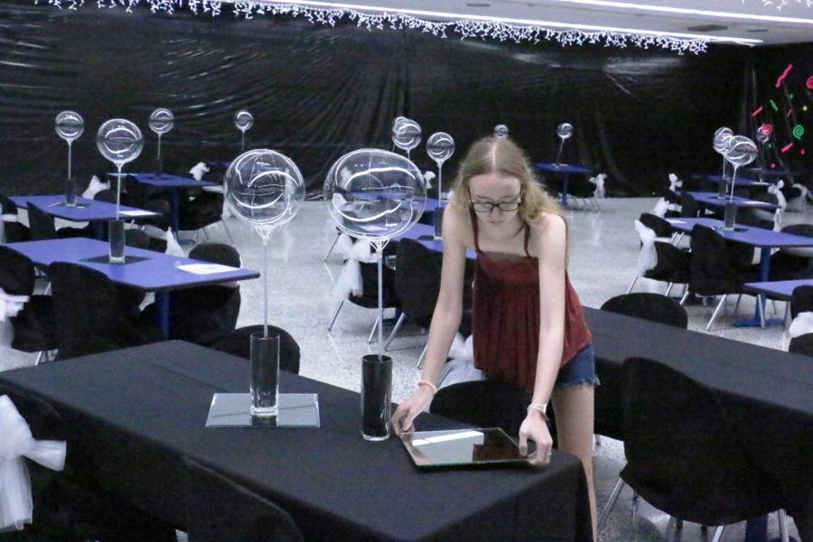 Senior Andee Junker puts the finishing touches on a table for last years Prom. This years Prom theme is A Night in Athens.